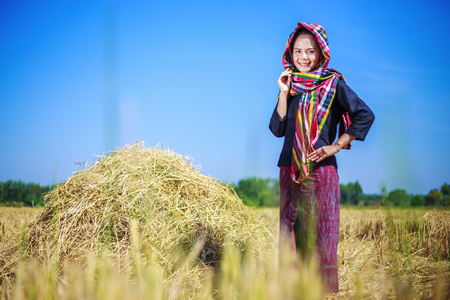 beautiful farmer woman with the straw in field, Thailand