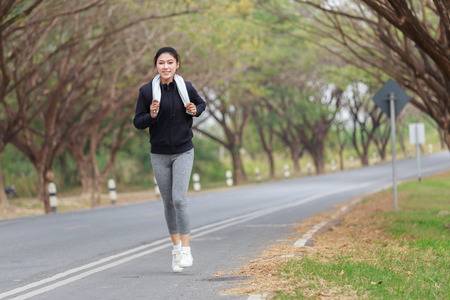 beautiful fitness woman running in the park