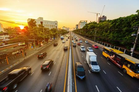 Bangkok, Thailand - March 3, 2018: traffic on Ngamwongwan Road with sunset at Kasetsart University in bangkok, Thailand 에디토리얼