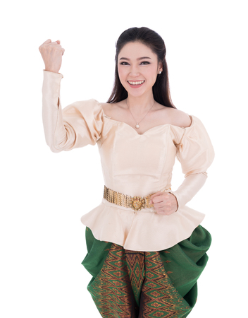 happy beautiful woman in Thai traditional dress isolated on white background Banco de Imagens
