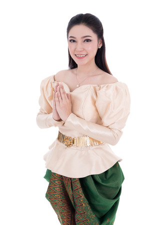 happy woman in Thai traditional dress is pay respect isolated on white background