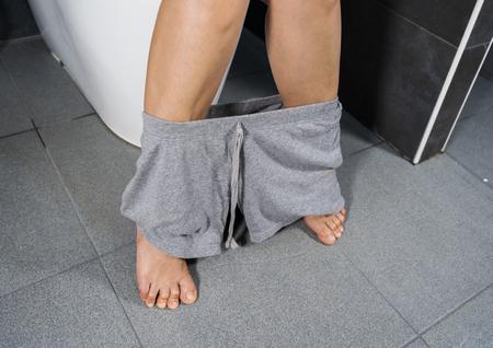 woman sitting on a toilet Stockfoto
