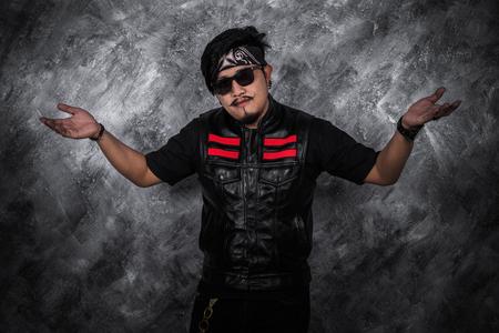 portrait of biker man in black leather jacket