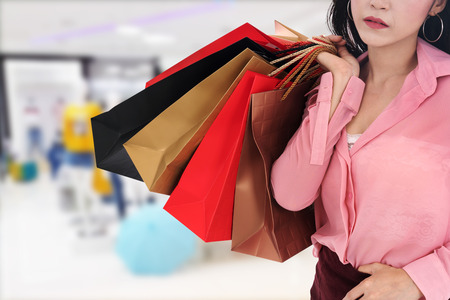 woman holding shopping bag at the mall