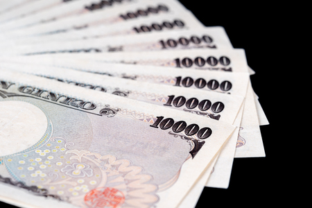 Japanese Banknote on black background, Yen is the official currency of Japan Imagens