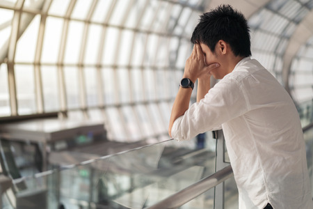 Stressed man waiting flight in airport
