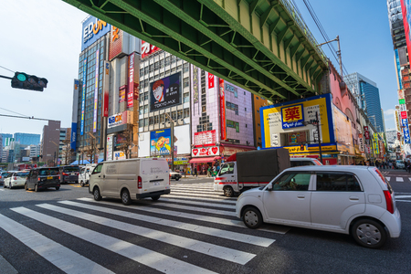 Akihabara, JAPAN - March 25, 2019: Cars pass through street in Akihabara at Tokyo, Japan