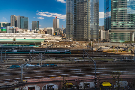 TOKYO, JAPAN - March 24, 2019: The local train approaching to the Tokyo railway station, Japan Фото со стока - 124337697