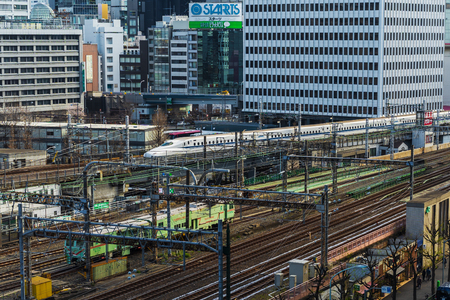TOKYO, JAPAN - March 24, 2019: The local train approaching to the Tokyo railway station, Japan