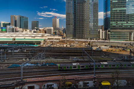 TOKYO, JAPAN - March 24, 2019: The local train approaching to the Tokyo railway station, Japan Фото со стока - 124412216