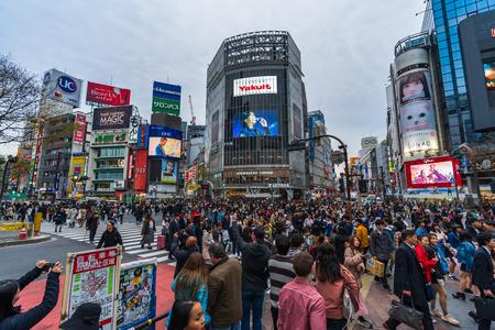 TOKYO , JAPAN - March 25, 2019: crowds of people walking across at Shibuya famous crossing street in Tokyo, Japan