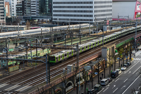 TOKYO, JAPAN - March 24, 2019: The local train approaching to the Tokyo railway station, Japan Фото со стока - 124412233