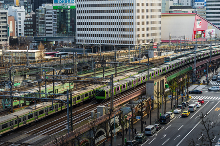 TOKYO, JAPAN - March 24, 2019: The local train approaching to the Tokyo railway station, Japan Фото со стока - 124412235