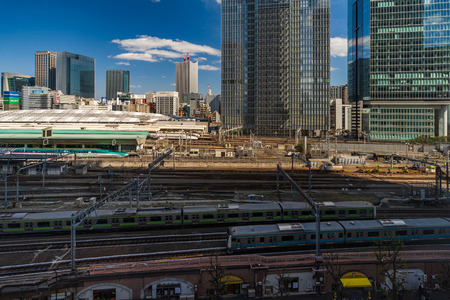 TOKYO, JAPAN - March 24, 2019: The local train approaching to the Tokyo railway station, Japan Фото со стока - 124412246