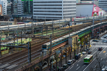 TOKYO, JAPAN - March 24, 2019: The local train approaching to the Tokyo railway station, Japan Фото со стока - 124412255