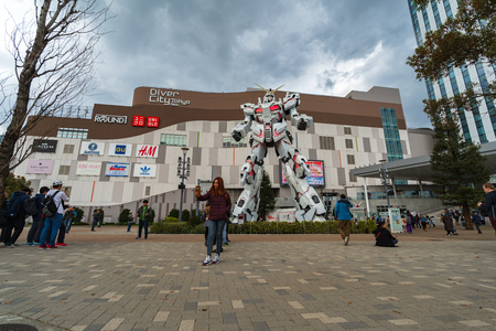 TOKYO, JAPAN - MARCH 28, 2019: Unidentified tourist visited statue of Gundam in front of the DiverCity Tokyo Plaza, Japan