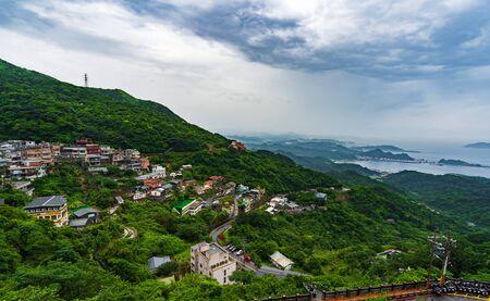 view of Jiufen village with mountain in raining day, Taiwan Banco de Imagens