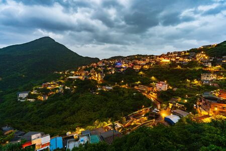 Jiufen village with mountain at night in raining day, Taiwan Banco de Imagens