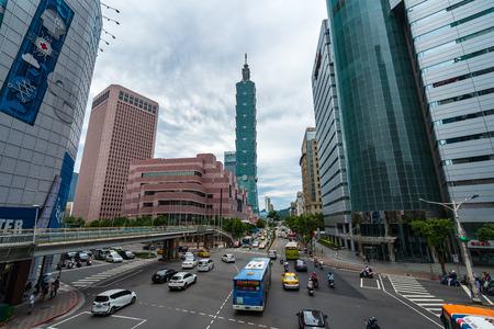 Taipei, Taiwan- 9 June, 2019: Taipei 101 tower with traffic on road in Taipei, Taiwan