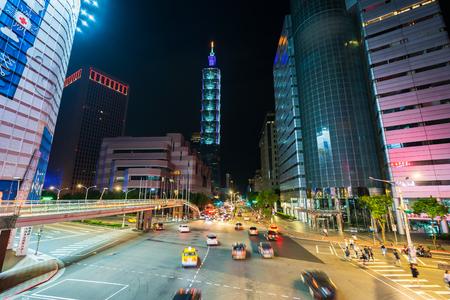 Taipei, Taiwan- 9 June, 2019: Taipei 101 tower with traffic on road at night in Taipei, Taiwan