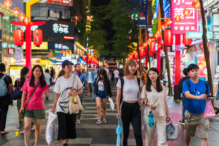 Taipei, Taiwan- 11 June, 2019: Crowd of people walking and shopping at Ximending street market at night in Taipei, Taiwan. Ximending is the famous fashion, night Market and street food in Taipei. Editorial