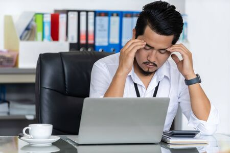 young stressed business man using laptop and working problem