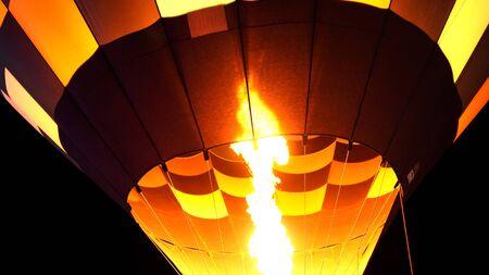 close up of hot air balloon burner flame glowing at a night Фото со стока