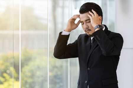 young stressed business man thinking about problem in office