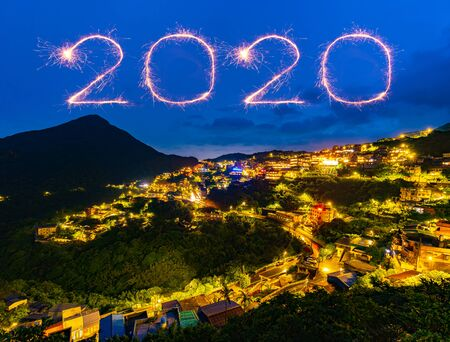 2020 happy new year fireworks celebrating over Jiufen old street city at night, Taiwan