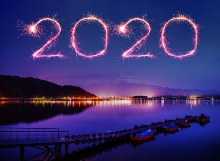 2020 happy new year fireworks celebrating over Mount fuji-san at Lake kawaguchiko in japan