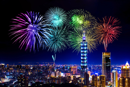 Fireworks celebrating over Taipei cityscape at night, Taiwan