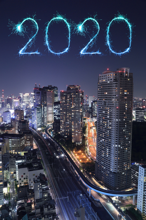 2020 happy new year fireworks celebrating over Tokyo cityscape at night, Japan Redactioneel