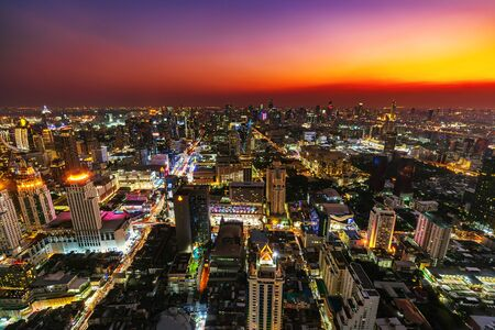 Bangkok city downtown and road traffic at sunset in Thailand , Cityscape