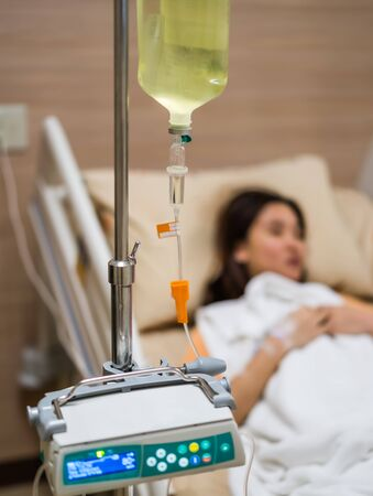 a saline with woman patient in hospital
