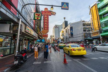 BANGKOK, THAILAND - AUG 9, 2020 : Crowded of people at Yaowarat road after COVID-19 virus pandemic. people must be wearing medical mask in Bangkok's Chinatown.