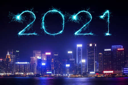 2021 Happy New Year fireworks celebrating over Hong Kong cityscape at night Stock Photo
