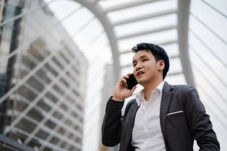 successful business man in suit talking a mobile phone in the city