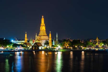 Wat Arun Temple with Chao Phraya river at night in Bangkok, Thailand