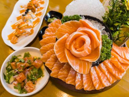 japanese food, fresh salmon sashimi (flower shape), slamon salat, shushi salmon