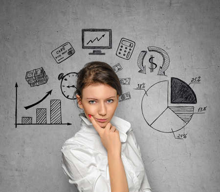 business cloth: Young pretty woman in office cloth on concrete wall background with business sketches