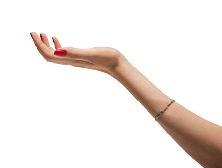 jewel hands: Photo of a hand of a woman with red manicure and bracelet Stock Photo