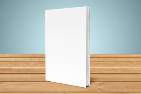 White copy-book are on the edge of a wooden table Stock Photo