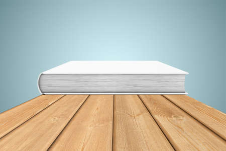 planking: White copy-book are on the edge of a wooden table Stock Photo