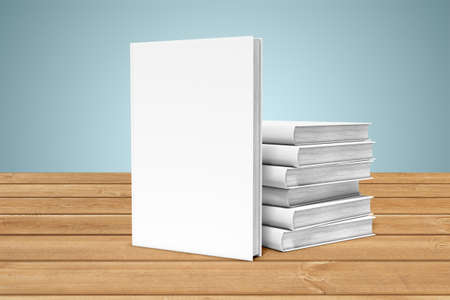 White copy-books are on the edge of a wooden table Stock Photo