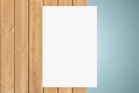 blanck: White copy-book are on the edge of a wooden table Stock Photo