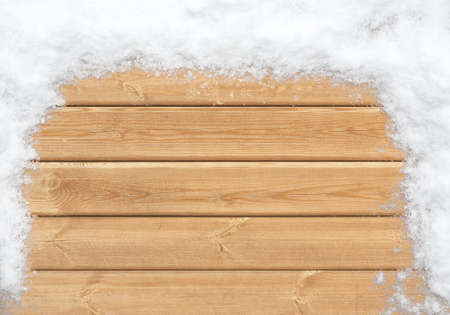 phon: Top view of wooden surface covered with snow Stock Photo