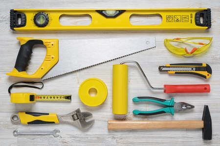Top view of construction instruments and tools on wooden DIY workbench. Banco de Imagens