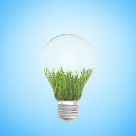 green energy: Green grass growing in a light bulb on a blue background
