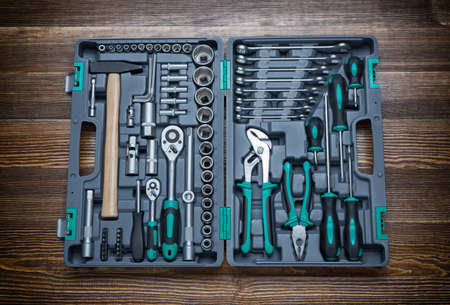 hand tool: Open toolbox with different instruments on workbench Stock Photo