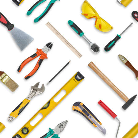 equipos: Conjunto de herramientas de construcción aisladas sobre un fondo blanco.